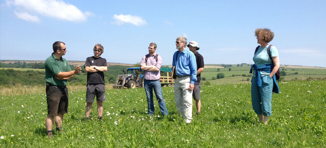 James Small (owner) showing guests around Warren Farm Somerset
