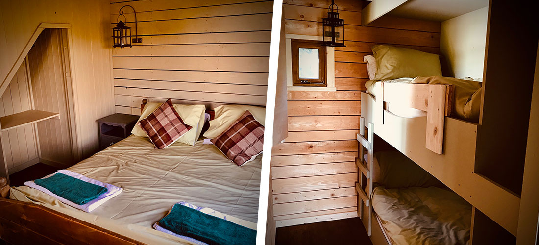 A view of the bedroom in the Deerleap Wooden Lodge